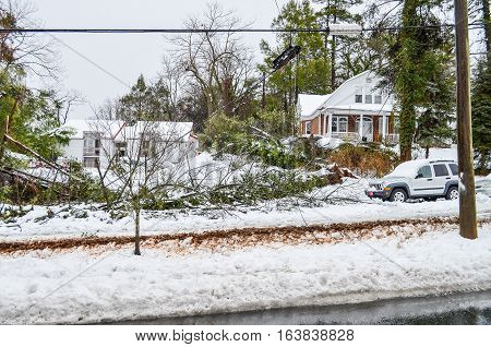 Charlottesville, USA - March 6, 2013: Jefferson Park Avenue with houses and broken telephone wires after snow storm