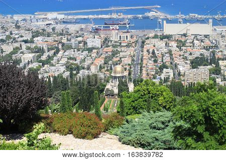 Beautiful panoramic landscape with Bahai Gardens and sea port in Haifa, Israel.