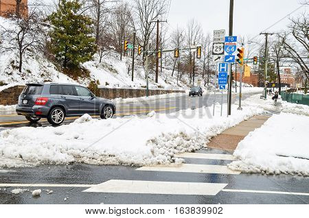 Charlottesville, USA - March 6, 2013: Jefferson Park Avenue after snow storm with cars and street signs