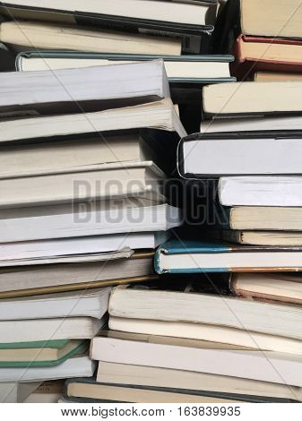 books piled as background texture for eduction or knowledge