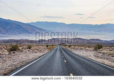 Road leading to Mesquite Sand Dunes in Death Valley California