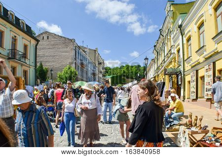 Kiev, Ukraine - May 25, 2013: Andriyivskyy Uzvoz Descent or Spusk with vendors selling souvenirs and people walking