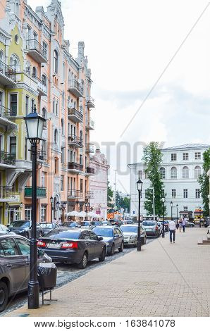 Kiev, Ukraine - June 6, 2013: Houses on street by Andriyivskyy Uzvoz Descent or Spusk with unique architecture and people walking