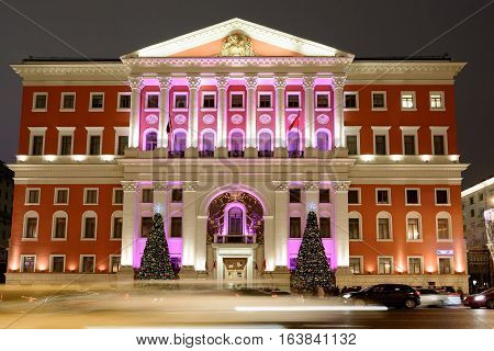 MOSCOW, RUSSIA - JANUARY 03, 2017: Night view of the Moscow Mayor's office building on Tverskaya street at christmas time with festive lights. Popular touristic landmark.
