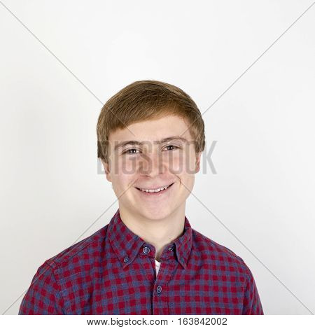 Portrait Of Happy Handsome Young Man On White Background