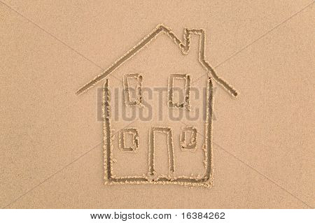 Sand drawing of a house.