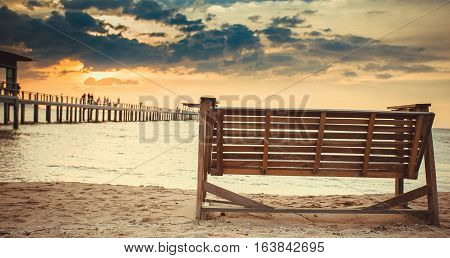 Rocking chairs on the Sand at beach front with blue sky Sunset