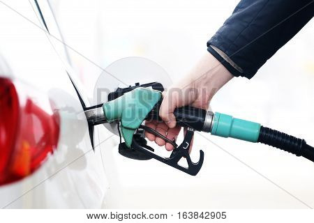 White car refueling on the petrol station