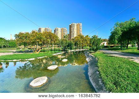 Turia Gardens Park in Valencia Spain with Buildings