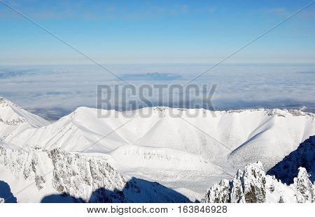 Panorama of mountain peaks in the High Tatras in winter from Lomnicky Peak Tatranska Lomnica Slovakia.