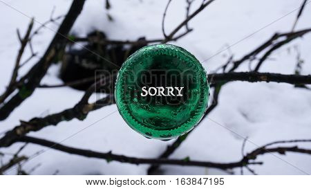 The Bottom Of The Beer Bottle,the Words On The  Sticker