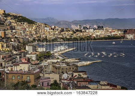 Panoramic view of the city of Napoli (Naples) with famous Mount Vesuvius and the harbour in the background, Campania, southern Italy