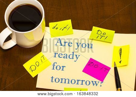 Are You Ready For Tomorrow Question - Handwriting On A Sheet Of Paper With  Cup Of Coffee