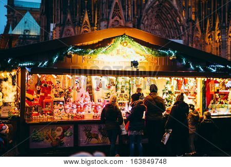 Market Stall In Strasbourg, France With Customers