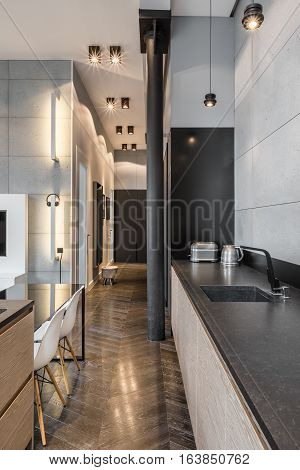 Kitchen With Black Countertop