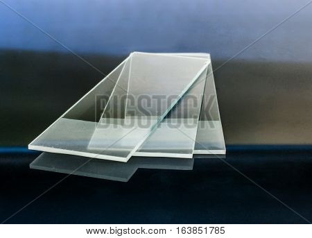 Microscope glass slides reflecting on glass table