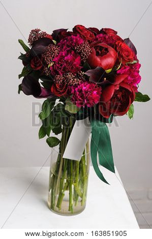 flower arrangement. Bouquet of red peonies. flowers in a glass vase.