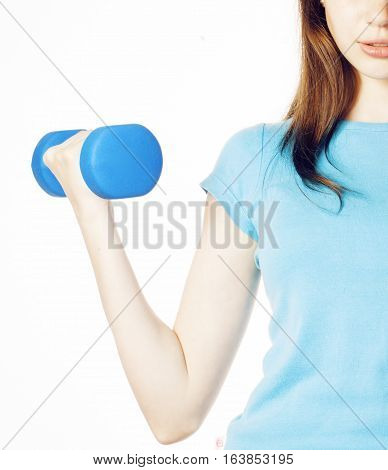 young pretty slim womans hand with dumbbell isolated, real sport girl next door, lifestyle people concept macro partly