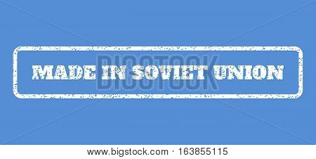 White rubber seal stamp with Made In Soviet Union text. Vector caption inside rounded rectangular shape. Grunge design and unclean texture for watermark labels. Horisontal emblem on a blue background.