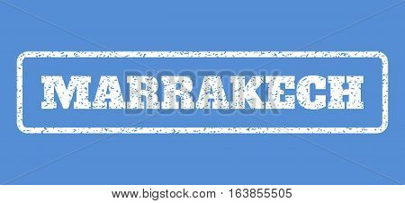 White rubber seal stamp with Marrakech text. Vector tag inside rounded rectangular banner. Grunge design and dust texture for watermark labels. Horisontal sign on a blue background.
