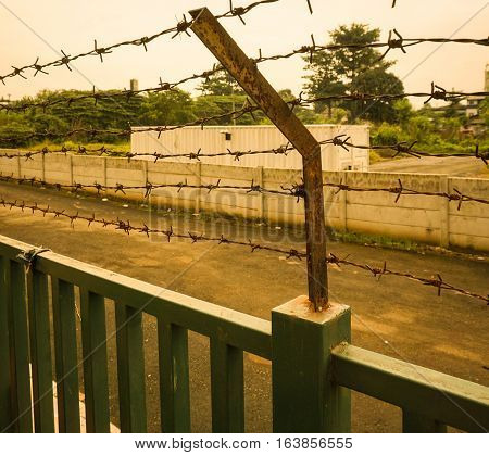 A rusty barbed wire fence at Kariadi General Hospital photo taken in Semarang Indonesia java