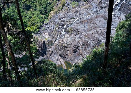 barron gorge national park and waterfalls descending from cliff in queensland australia