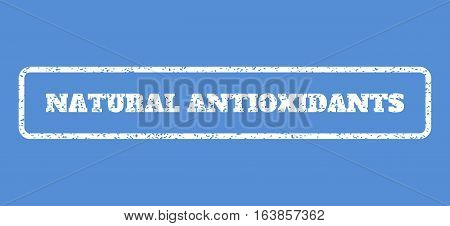 White rubber seal stamp with Natural Antioxidants text. Vector tag inside rounded rectangular banner. Grunge design and unclean texture for watermark labels. Horisontal sticker on a blue background.