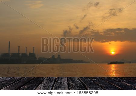 close up wood table on sunrise background