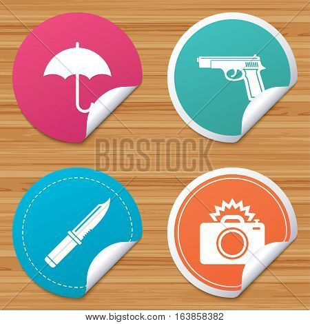 Round stickers or website banners. Gun weapon icon.Knife, umbrella and photo camera with flash signs. Edged hunting equipment. Prohibition objects. Circle badges with bended corner. Vector