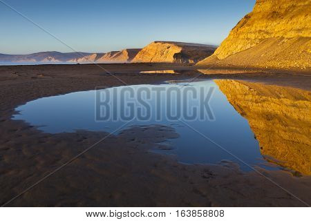 Cliffs reflected in tide pool. Drakes Beach CA poster
