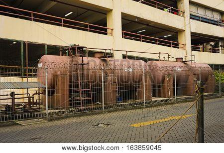 Red water tank near parking lot photo taken in Semarang Indonesia java