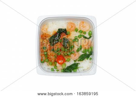 Fried shrimps with basil leaves in microwaveable food box isolated