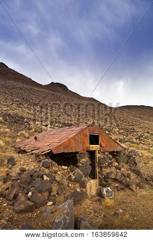 Old abandoned dugout with tin roof at the Ghost Town of Candelaria in Nevada.