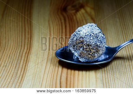 Tin Foil Heroin Lump On Silver Spoon