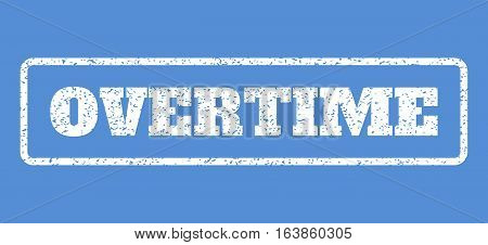 White rubber seal stamp with Overtime text. Vector message inside rounded rectangular frame. Grunge design and unclean texture for watermark labels. Horisontal sticker on a blue background.