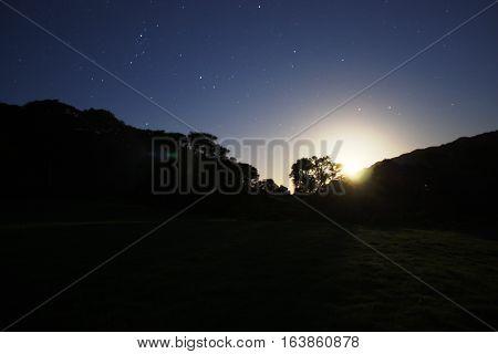moon rising over cadair idris mountain range in Snowdonia national park Wales