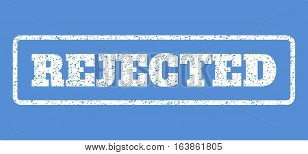 White rubber seal stamp with Rejected text. Vector tag inside rounded rectangular frame. Grunge design and dust texture for watermark labels. Horisontal sticker on a blue background.