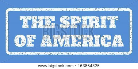 White rubber seal stamp with The Spirit Of America text. Vector caption inside rounded rectangular banner. Grunge design and dust texture for watermark labels. Horisontal emblem on a blue background.
