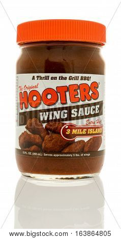 Winneconne WI - 2 January 2017: Bottle of Hooters wing sauce on an isolated background.