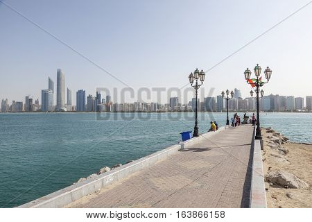 ABU DHABI UAE - NOV 26 2016: Skyline of Abu Dhabi as seen from the corniche. United Arab Emirates Middle East