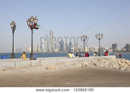 ABU DHABI UAE - NOV 26 2016: Skyline of Abu Dhabi downtown as seen from the corniche. United Arab Emirates Middle East