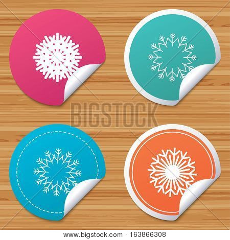 Round stickers or website banners. Snowflakes artistic icons. Air conditioning signs. Christmas and New year winter symbols. Frozen weather. Circle badges with bended corner. Vector
