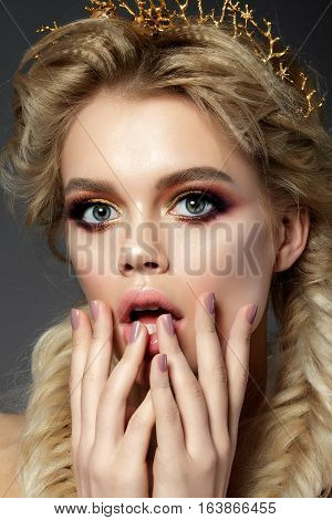 Beauty portrait of young funny surprised woman. Modern trendy makeup. Studio shot