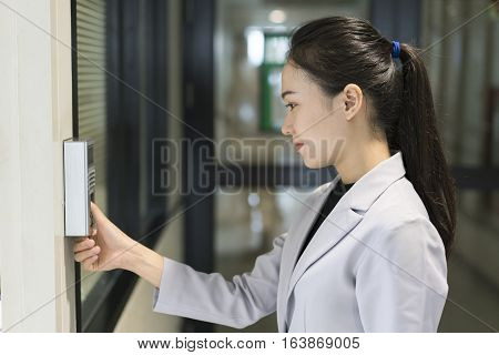 Woman scaning finger print for enter security system