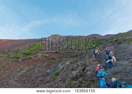 Crowds Of Climbers At The Summit.
