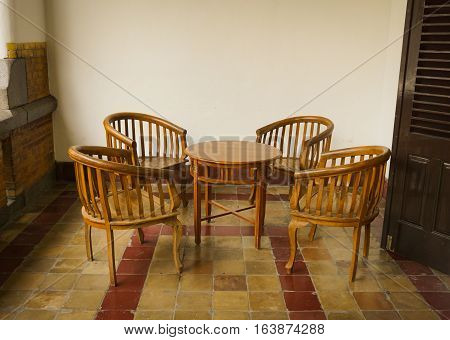 set of table and chairs made from wood at Lawang Sewu building photo taken in Semarang Indonesia java