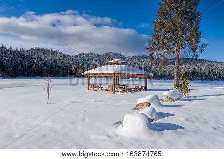 A small park with a pavilion during winter in Spirit Lake Idaho.