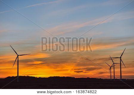 Silhouette Of Wind Turbine On Sunset