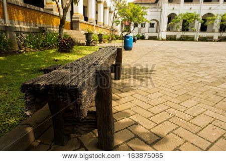 A bench made froom wood at Lawang Sewu photo taken in Semarang Indonesia java