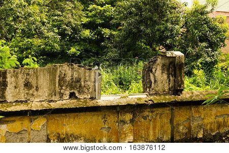 Abandoned building debris in a garden photo taken in Semarang Indonesia java